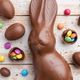 Chocolate Easter bunny, eggs and sweets on rustic background - PhotoDune Item for Sale