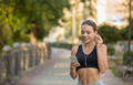 Girl choose music for running on smartphone - PhotoDune Item for Sale