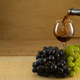 Bunches of grapes and a glass of wine on a wooden background - PhotoDune Item for Sale