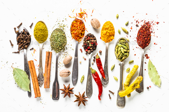 Set of indian spices in spoons on white - Stock Photo - Images