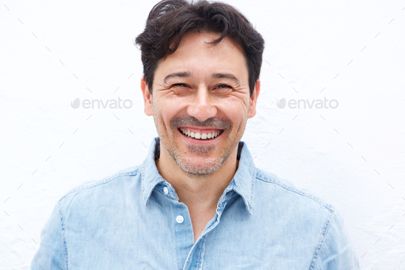 handsome mature guy smiling against white background - Stock Photo - Images