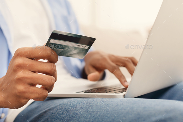 Man purchasing product online, using credit card to pay - Stock Photo - Images
