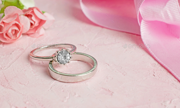 A Pair of Silver Wedding Rings - Stock Photo - Images