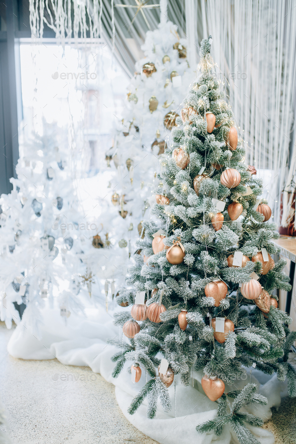 Christmas fir tree decorated with golden toys - Stock Photo - Images