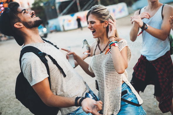 Group of friends having fun time at music festival - Stock Photo - Images