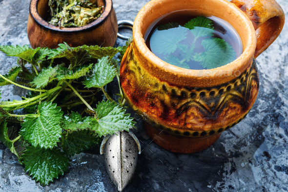 Tea with fresh nettles - Stock Photo - Images