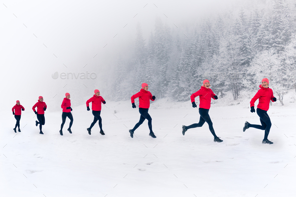 Two women trail running on snow in winter mountains - Stock Photo - Images