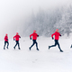 Two women trail running on snow in winter mountains - PhotoDune Item for Sale