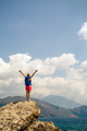 Woman with arms outstretched celebrate mountains sunrise - PhotoDune Item for Sale