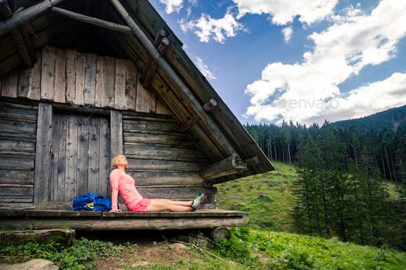 Woman camping and looking at inspiring mountain landscape - Stock Photo - Images