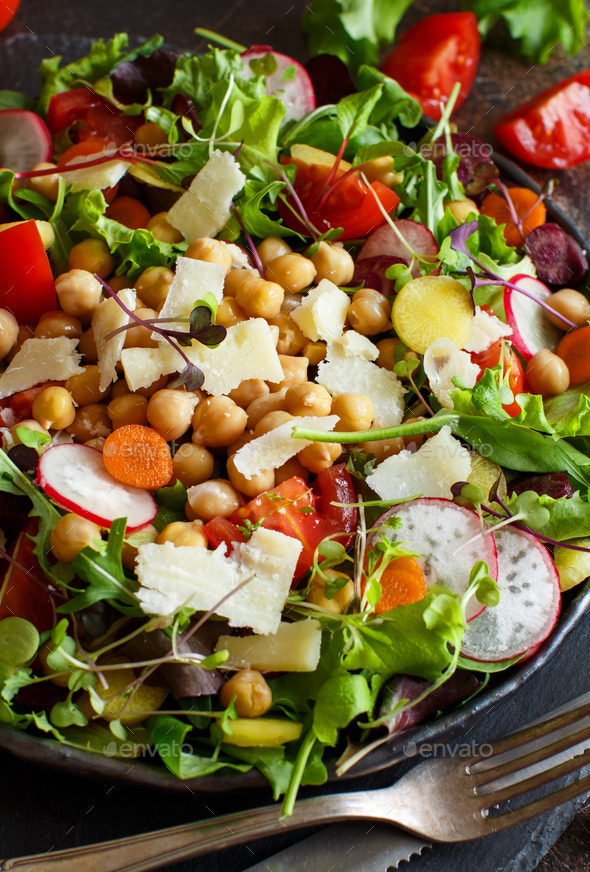 Chickpea salad with vegetables and microgreens - Stock Photo - Images