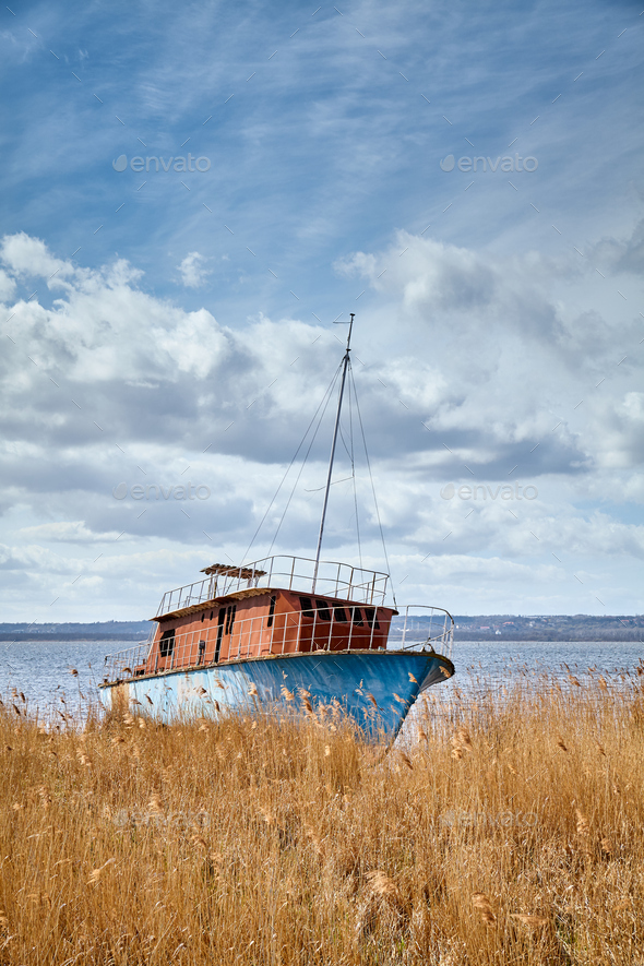 Landscape with a shipwreck and beautiful cloudscape. - Stock Photo - Images
