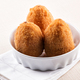 Three deep fried Arancini from Sicily in a bowl - PhotoDune Item for Sale