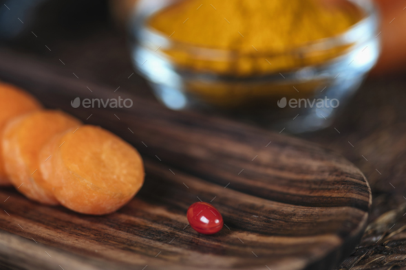 Beta Carotene Supplement Pills and Vegetables - Stock Photo - Images