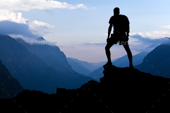 Man hiking success silhouette in mountains - Stock Photo - Images