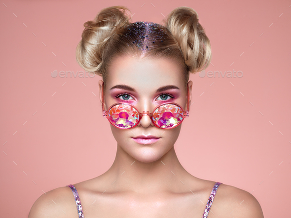 Portrait of beautiful young woman with colored glasses - Stock Photo - Images