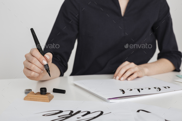 Beautiful photo of young woman hands writing on paper on desk  isolated - Stock Photo - Images