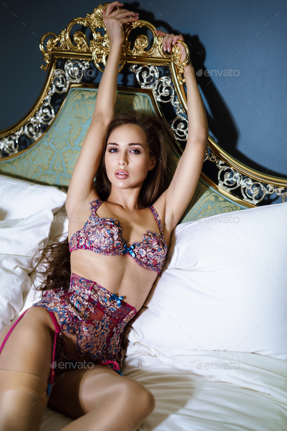 Beautiful sexy lady in pink panties and bra on the bed - Stock Photo - Images
