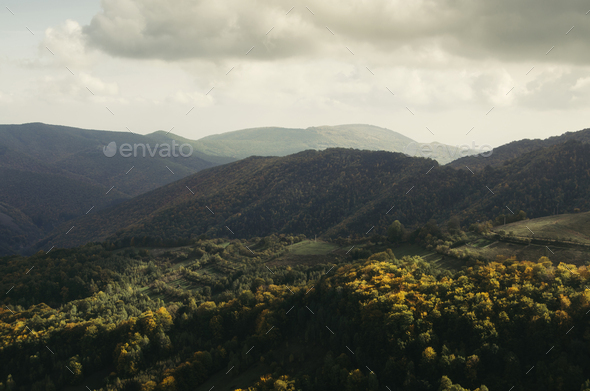 Panoramic view of hills and mountains in natural autumn landscape - Stock Photo - Images
