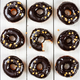 Donuts with chocolate mirror icing on wooden background. - PhotoDune Item for Sale