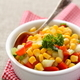Homemade corn salsa in white bowl with spoon - PhotoDune Item for Sale