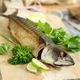 Smoked mackerel with lime and parsley on wooden board - PhotoDune Item for Sale