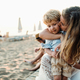 Young mother with a toddler boy having fun on beach on summer holiday. - PhotoDune Item for Sale