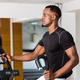 Black African American  young man doing cardio workout at the gy - PhotoDune Item for Sale