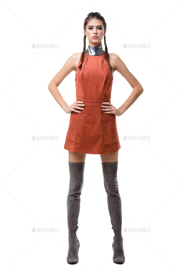 Young pretty lady standing in light brown dress and knee high boots on white background - Stock Photo - Images