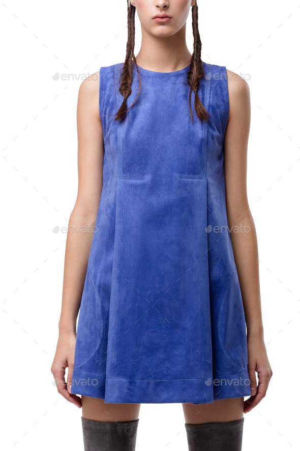 Close up photo of young lady standing in blue suede dress on white background - Stock Photo - Images