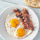 Fried eggs and bacon on the white plate - PhotoDune Item for Sale