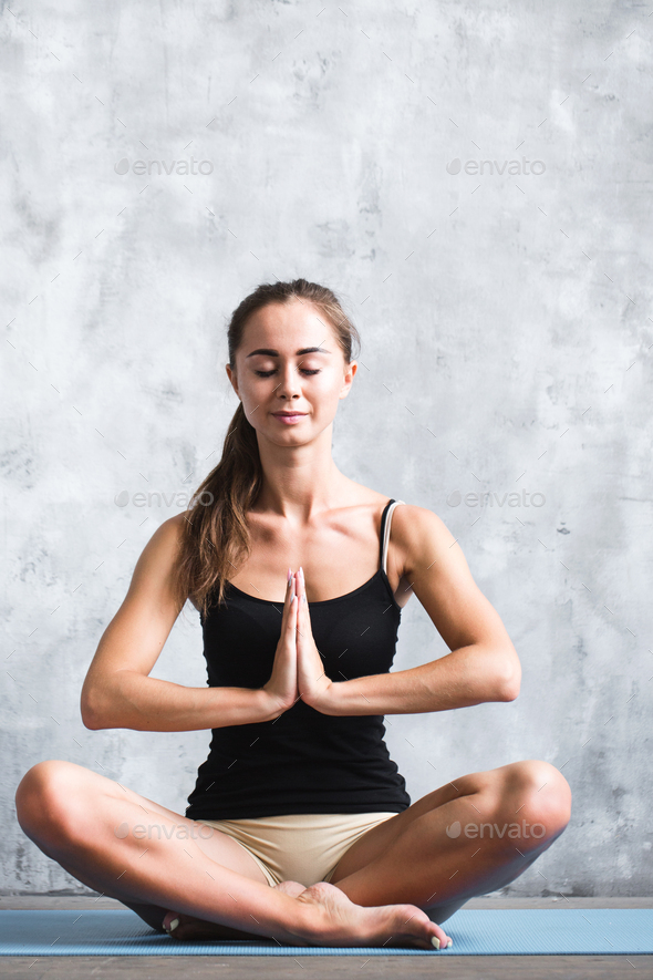 Beautiful young woman doing yoga exercises. - Stock Photo - Images