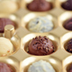 Assorted of chocolate candies in gold gift box. Selective focus - PhotoDune Item for Sale