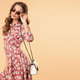 Sweet and charming girl in pretty summer dress with handbag and sunglasses - PhotoDune Item for Sale