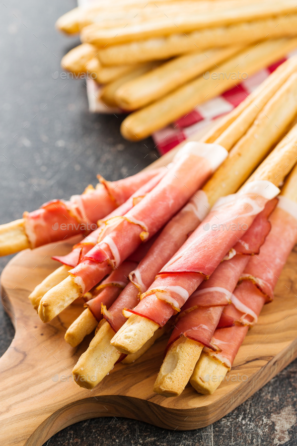 Parma ham prosciutto with grissini breadsticks. - Stock Photo - Images