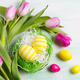 Easter greeting with yellow eggs in the nest and pink tulips - PhotoDune Item for Sale