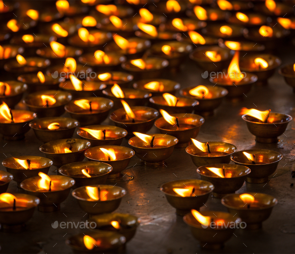 Burning candles in Buddhist temple, McLeod Ganj - Stock Photo - Images
