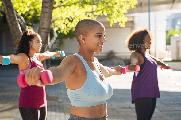 Three curvy women exercising with dumbbells - Stock Photo - Images