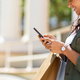 Woman with shopping bags using phone - PhotoDune Item for Sale