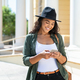 Latin woman using phone - PhotoDune Item for Sale