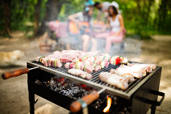 Grilled meat with vegetables over the coal on barbecue - Stock Photo - Images