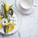 Spring Easter Table setting at white marble table. Top view - PhotoDune Item for Sale