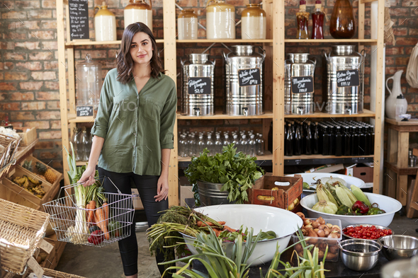 Portrait Of Woman Buying Fresh Fruit And Vegetables In Sustainable Plastic Free Grocery Store - Stock Photo - Images