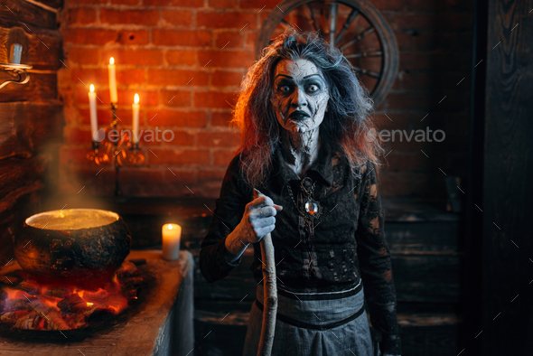 Scary witch on spiritual seance, cooking - Stock Photo - Images