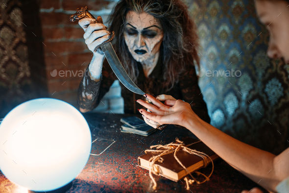Scary witch with knife, spiritual seance - Stock Photo - Images