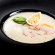 Homemade sour soup served with egg on dark plate - PhotoDune Item for Sale