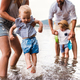 A midsection of family with two toddler children outdoors by the river in summer. - PhotoDune Item for Sale