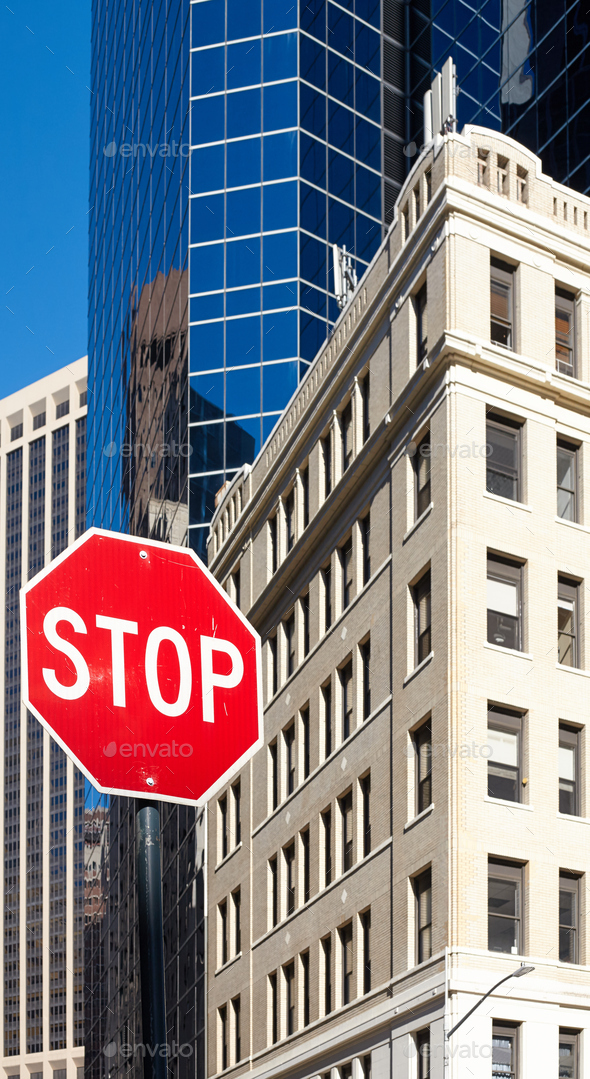 Stop sign on a street of New York City. - Stock Photo - Images