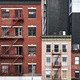 Old tenement houses with fire escapes in New York. - PhotoDune Item for Sale