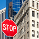 Stop sign on a street of New York City. - PhotoDune Item for Sale
